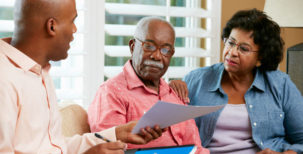 Financial planner helping out an elderly couple