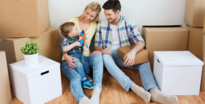 Young parents with son in new home