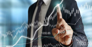 Business man in front of a finance chart
