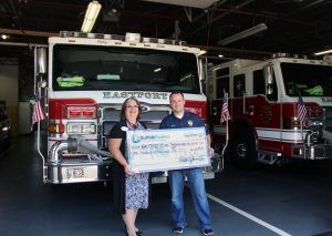 Pictured left to right: Debra Castro, Eastport Branch Manager of Suffolk Federal and Mark Yakabowski, Chief of the Eastport Fire Department.